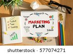 Small photo of Notebook with Toolls and Notes about Marketing Plan