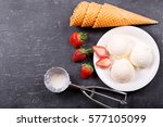 Stock photo plate of ice cream scoops with fresh strawberry and waffle cones on dark background top view with 577105099