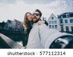 happy young couple in love... | Shutterstock . vector #577112314