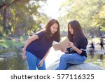 pretty asian students reading... | Shutterstock . vector #577116325