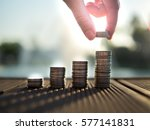 hand putting money coins stack... | Shutterstock . vector #577141831