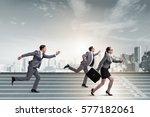 businesspeople running in... | Shutterstock . vector #577182061