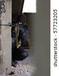 terrorist in black uniform... | Shutterstock . vector #57723205