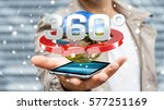 Small photo of Man on blurred background holding 360 degree 3D render icon over mobile phone