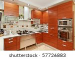 Stock photo kitchen interior with wooden furniture and many utensils in warm tones on wide angle view 57726883