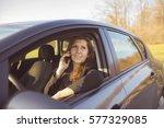 mature business woman in car | Shutterstock . vector #577329085