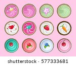colored cupcakes set on pink... | Shutterstock .eps vector #577333681