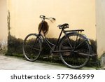 raised old black bicycle... | Shutterstock . vector #577366999