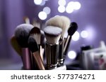 make up brushes on the violet... | Shutterstock . vector #577374271