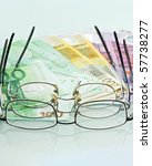 eyeglasses and currencies | Shutterstock . vector #57738277