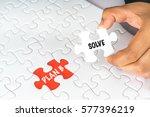hand holding white jigsaw...
