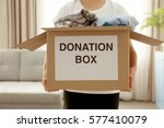 donation box with clothing in... | Shutterstock . vector #577410079