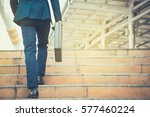 business man holding a... | Shutterstock . vector #577460224