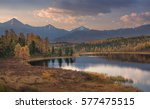 mirror surface lake beautiful... | Shutterstock . vector #577475515