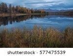 mirror surface lake autumn... | Shutterstock . vector #577475539