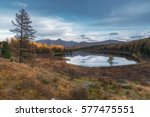 mirror surface lake... | Shutterstock . vector #577475551