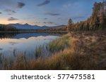 mirror surface lake autumn... | Shutterstock . vector #577475581