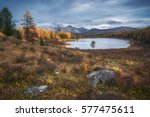 mirror surface lake... | Shutterstock . vector #577475611