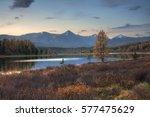 mirror surface lake autumn... | Shutterstock . vector #577475629