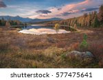 mirror surface lake early... | Shutterstock . vector #577475641