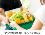 delivery man delivering food to ... | Shutterstock . vector #577484539