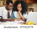 sad african family facing...   Shutterstock . vector #577523779
