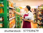 Small photo of Sales Clerk At The Supermarket