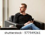 pensive man wearing a black... | Shutterstock . vector #577549261