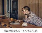 Stock photo pretty freelancer tall woman with short disheveled hair plaid shirt and glasses checks the email 577567351