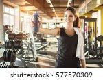 sporty woman with water bottle... | Shutterstock . vector #577570309