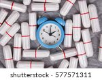 Small photo of Cotton tampons with clock. Woman critical days, woman hygiene protection. Menstruation