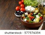 tasty greek salad with feta ... | Shutterstock . vector #577576354
