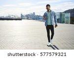 handsome male tourist in trendy ... | Shutterstock . vector #577579321