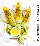 fresh corn on the cobs with dip | Shutterstock . vector #577581631