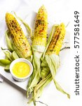 fresh corn on the cobs with dip | Shutterstock . vector #577581649