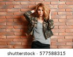 pretty woman in military jacket ... | Shutterstock . vector #577588315