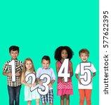 little kids holding number smile | Shutterstock . vector #577622395