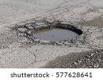 water filled pot hole in the... | Shutterstock . vector #577628641
