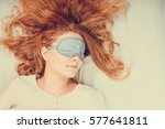 tired woman sleeping in bed... | Shutterstock . vector #577641811