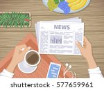 man reading the latest news at... | Shutterstock .eps vector #577659961