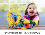 Happy Little Girl Playing With Toys At Home - stock photo