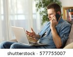 angry man having problems on... | Shutterstock . vector #577755007