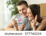 hopeful couple checking a... | Shutterstock . vector #577760224