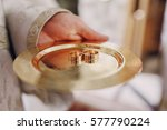 on a gold plate are two gold... | Shutterstock . vector #577790224