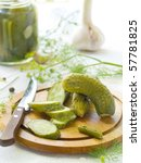 Fresh salted cucumber on plate with dills - stock photo