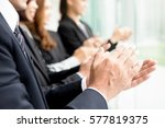 group of business people giving ... | Shutterstock . vector #577819375