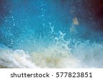 Small photo of In captivity waterfall. Falling and swirling water, streaming and foam, splashes, rainbow on surface of waterfall at different sites, stochastic motion