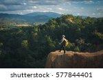 man traveler with backpack... | Shutterstock . vector #577844401