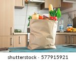 Small photo of Paper bag full variety of useful food on a wooden table in the kitchen close up