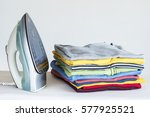 ironing clothes on ironing board | Shutterstock . vector #577925521